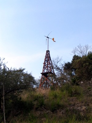 wind turbine at Bear Springs Blossom Nature Preserve is using solar power to produce up to 1000 watts and hour - wind power is renewable energy without pollution